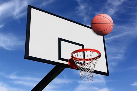 a basketball and a panel of basketball on a background of blue sky Stock Photo