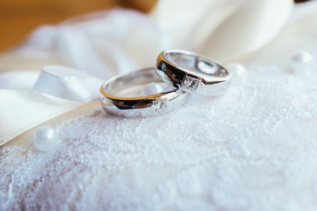 Beautifull wedding rings on white lace pillow
