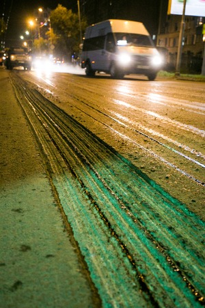 dangerouse: Road construction site with new asphalt at the evening