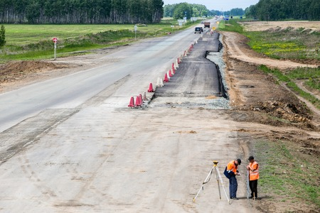 roadwork: Russia, Omsk - June 2: Road construction site, roadside stones and gravel with road sign on June 2th 2015 in Omsk