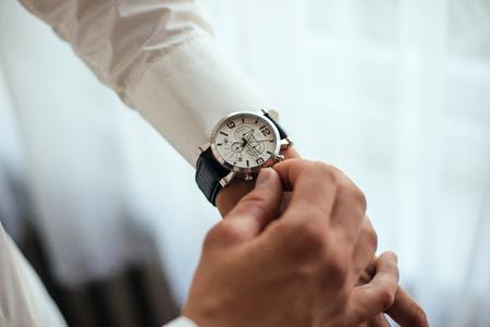 timepiece: Businessman look his watch in white shirt