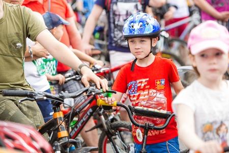 bikercross: Omsk, Russia - June 6, 2015: Children at Bike marathon in Omsk