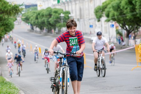 Omsk, Russia - June 6, 2015: Boy at Cycling marathon in Omsk Editorial