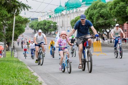 bikercross: Omsk, Russia - June 6, 2015: Man with daughter at Bike festival in Omsk