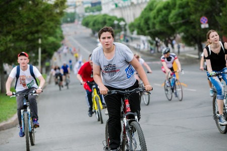 bikercross: Omsk, Russia - June 6, 2015: Boy at Bike marathon in Omsk Editorial