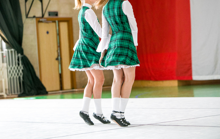 turnout: Irish dancing legs in national shoes and dress