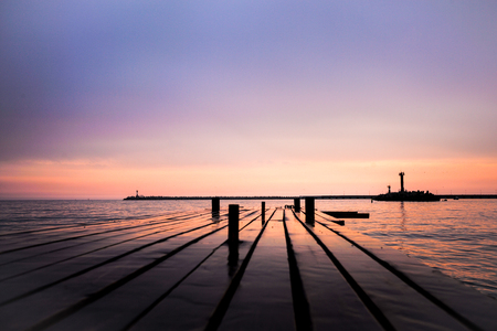 woody bay: Purple sunset with beautiful sky and pier for background Stock Photo