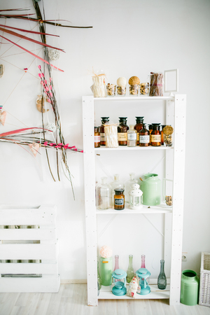 shabby: Wooden shelf with decorative elements against white wall in light cozy room