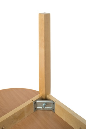 mounting: New brown wooden table on white background with mounting and details upside down Stock Photo