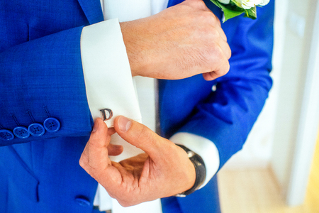 stud: man in a blue suit, hands with stud