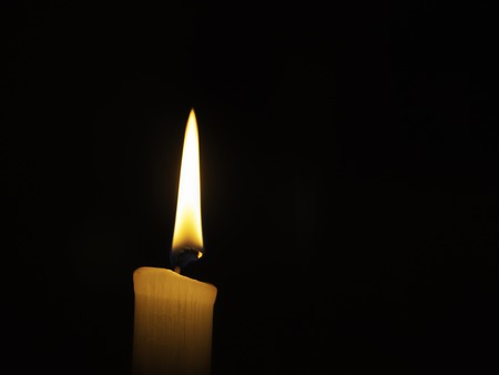 candlelight with fire on a black background. Stock Photo