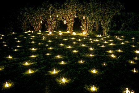 candle light decoration on the summer grass at night for date