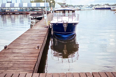 polis: Boats moored in harbour with wooden berth at port