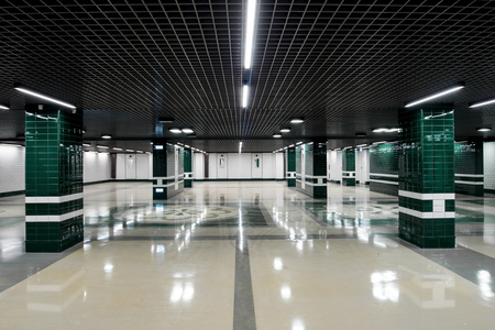 underground passage: Underground passage in modern building with white-emerald color Stock Photo