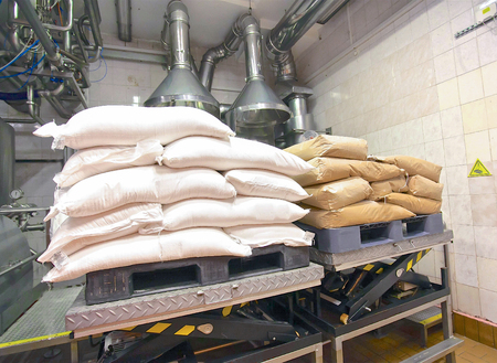 milk flour cream storage bags white and beige in the factory storage