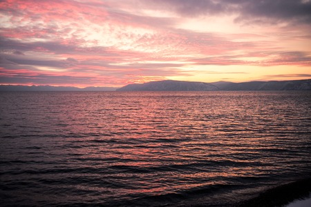pink sunset: Beautiful seaside pink sunset and mountain view