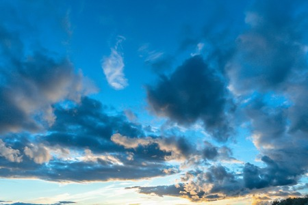 ble: Cloudsape sunset sky white, blue and gold colored
