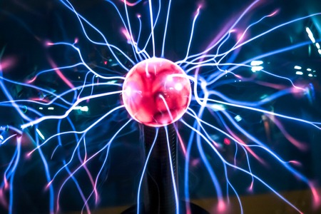 bewitch: Close-up plasma ball lights  with magenta-blue flames isolated on black background