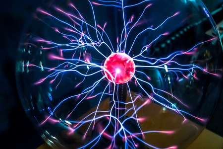 bewitch: Magic plasma ball  close-up  with magenta-blue flames on the dark background