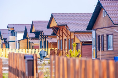 residental: Wooden houses residental community made in one-style with dark-brown color roofs