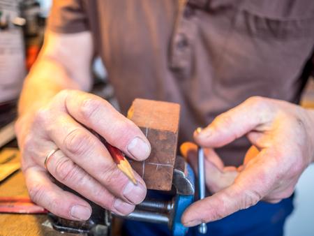 working hands: Hands of the craftsman working in workshop