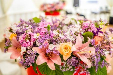 bouqet: Close-up beautiful flower bouqet from gentle roses and pink lilies with wild flowers.