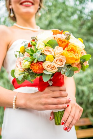 bouqet: Close up bridal roses bouqet with different colors- white, orange, pink and green leaves