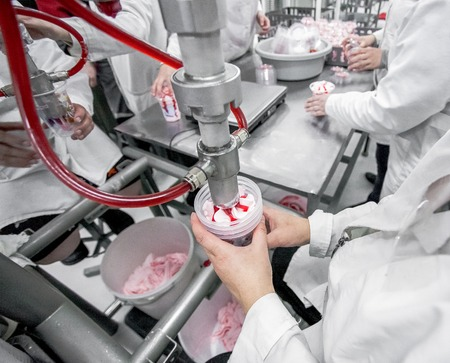 Production of white ice-cream - convair at factory Imagens - 54434660