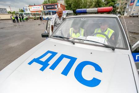raid: Omsk, Russia - July 10, 2015: Police car on the street at traffic police raid Editorial