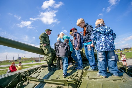 solders: Omsk, Russia - May 8, 2015: victory parade, kids on tank
