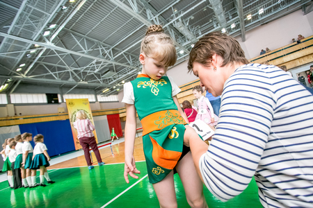 preperation: Omsk, Russia - August 22, 2015: International  competition of irish dance, preperation liitle girl