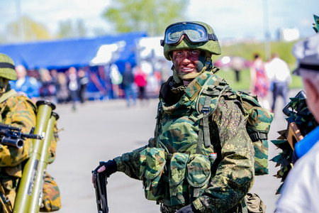 annexation: Omsk, Russia - May 8, 2015: victory parade, a soldier with gun Editorial
