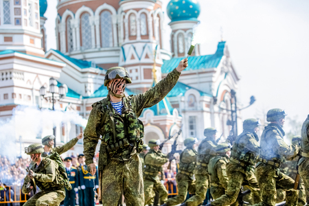Omsk, Russia - May 8, 2015: victory parade, a soldier with gun near church Editorial