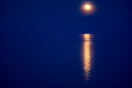 gleam: Moon light gleam in water. Deep blue covered landscape - beautiful background