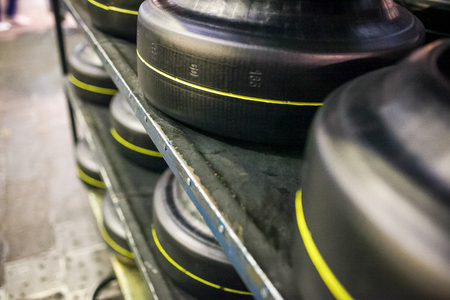 workpiece: warehouse with workpiece with yellow line of car tires at factory close up Stock Photo