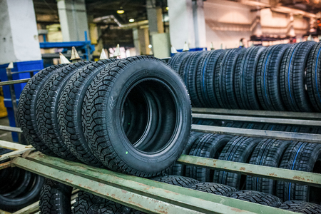 Group of new tires ready for transporting and sale at factory storage