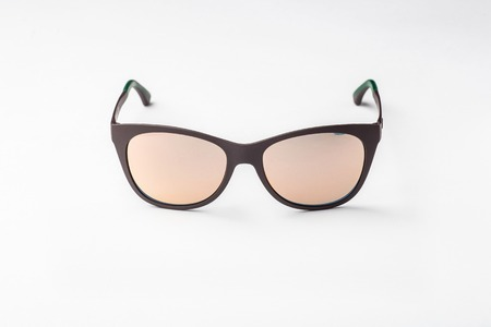 womans: womans sunglasses with brown lens isolated against a white background Stock Photo