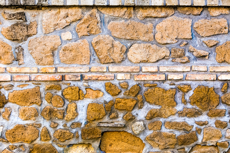 overbuilding: old bright stone wall texture classic facade