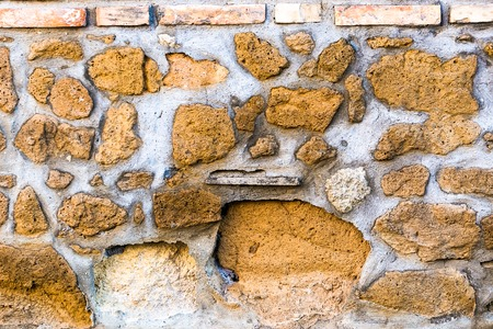 overbuilding: old bright stone wall texture classic facade close up