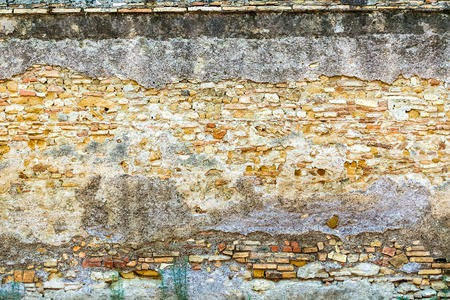sidewall: Old brick wall with crumbling plaster backround classical facade