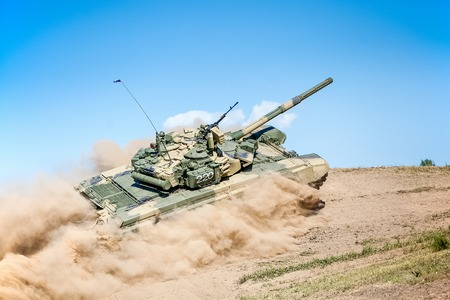 Omsk, Russia - July 07, 2011: International exhibition of high-tech equipment and weapons, tank on maneuvers, motion on hill Editorial