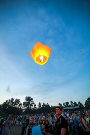 afloat: Omsk, Russia - June 16, 2012: festival of Chinese paper lantern, the crowd starts them in the sky