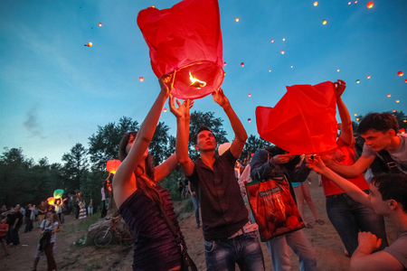 flying float: Omsk, Russia - June 16, 2012: festival of Chinese paper lantern, the crowd starts them in the sky