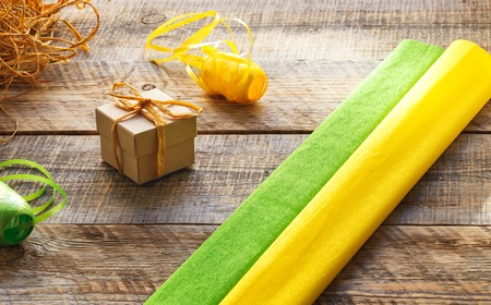 preperation: Craft gift boxes on wooden background with ribbon and straw - preperation.