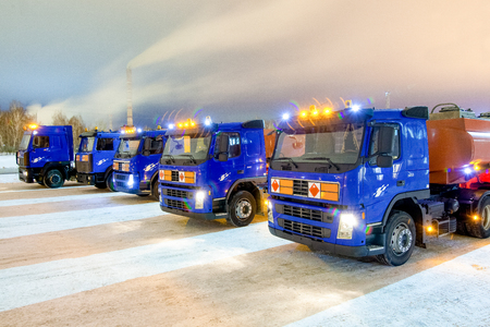 cary: trucks for dangerous materials at winter outside
