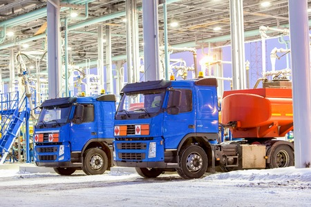 trucks for dangerous materials at winter outside close up Stock Photo
