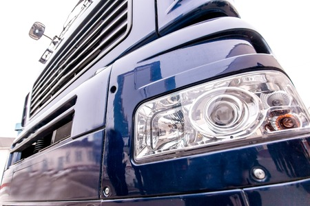 freightliner: Front light of a modern truck - xenon light bulbs, steps and front bumper Stock Photo