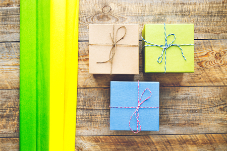 preperation: Colored gift boxes on wooden background with ribbon - preperation.