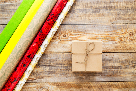 preperation: Craft gift box on wooden background with ribbon - preperation.