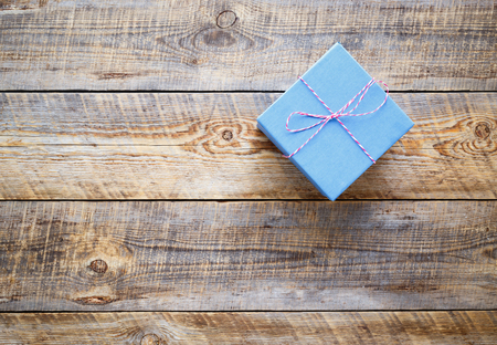 blue gift box: blue gift box on wooden background close up